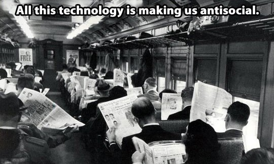 Train carriage reading newspapers - All this technology is making us antisocial